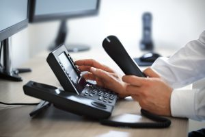 person-using-voip-phone